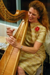 Bonnie with harp at Xmas